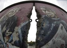 <p>A mural is pictured at the 'East Side Gallery' in Berlin, October 15, 2008. On Wednesday renovation works starts on parts of the 1.3 kilometre open air gallery of murals that is a part of the former Berlin Wall, which shows artworks of 118 artist from 24 countries. REUTERS/Tobias Schwarz</p>
