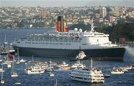 The Queen Elizabeth 2 arrives in Sydney harbour, accompanied by a flotilla of small craft, in this file photo from February 20, 2007. REUTERS/Stringer