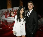 """<p>Cast members Vanessa Hudgens and Zac Efron pose at the premiere of the movie """"High School Musical 3: Senior Year"""" at Galen Center in Los Angeles October 16, 2008. REUTERS/Mario Anzuoni</p>"""