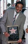<p>Levi Stubbs, the lead singer of the group The Four Tops, poses during unveiling ceremonies for the band's new star on the Hollywood Walk of Fame in Hollywood, California, this April 23, 1997 file photo. REUTERS/Files</p>