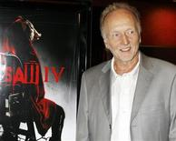 """<p>Tobin Bell, who stars as """"Jigsaw"""", poses as he arrives at a screening for the cast and crew of his new film """"Saw IV"""" in Hollywood October 23, 2007. REUTERS/Fred Prouser</p>"""