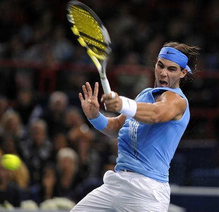 Rafael Nadal of Spain returns the ball to Gael Monfils of France during their match in the Paris Masters Series tennis tournament, October 30, 2008. REUTERS/Jacky Naegelen