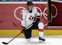 <p>Canada's Wade Redden rests in the second period of their men's hockey game at the Torino 2006 Winter Olympic Games in Turin, Italy February 18, 2006. REUTERS/Shaun Best</p>