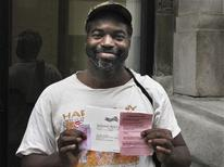 "<p>Frederick Williams, a Marine Corps veteran who lives in a transient hotel on ""skid row"" in downtown Los Angeles, displays his ballot receipt after casting his ballot for the U.S. presidential election, at a homeless shelter in Los Angeles November 4, 2008. REUTERS/Steve Gorman</p>"