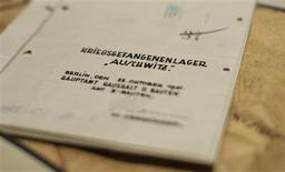 """<p>Architect's drawings of the Nazi death camp at Auschwitz are pictured in an office of Germany's Bild newspaper in Berlin November 9, 2008. The original construction plans believed used for a major expansion of the Nazi death camp at Auschwitz in 1941 have been found in a Berlin flat, Germany's Bild newspaper reported on Saturday. Words read: """"Prisoners of war camp Auschwitz"""". REUTERS/Bild Zeitung</p>"""
