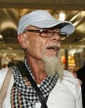 <p>British rocker Gary Glitter walks at Bangkok's Suvarnabhumi Airport August 20, 2008. REUTERS/Sukree Sukplang</p>
