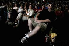"<p>Filmmaker Michael Moore watches his documentary ""SiCKO"" during a special screening for the California Nurses Association (CNA) at the Crest Theater in Sacramento June 12, 2007. REUTERS/Max Whittaker</p>"