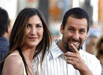 "<p>Cast member Adam Sandler gestures next to his wife Jackie at the premiere of ""I Now Pronounce You Chuck and Larry"" at the Gibson amphitheater in Universal City, California July 12, 2007 .REUTERS/Mario Anzuoni</p>"