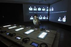 <p>Video and installation by artists Chen Tong and Jean-Philippe Toussaint are displayed at the Guangzhou Museum of Art in southern China in this September 19, 2008 handout photo. REUTERS/Guangdong Museum of Art/Handout</p>