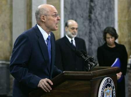 U.S. Treasury Secretary Henry Paulson announces that the Treasury Department will take equity stakes in potentially thousands of banks totaling about $250 billion at the Treasury Department Cash Room in Washington, October 14, 2008. Standing beside Paulson are Federal Reserve Chairman Ben Bernanke (C) and FDIC Chairman Sheila Bair. REUTERS/Hyungwon Kang