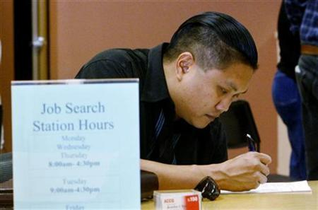 Joseph Sullivan fills out a form at the Verdugo Jobs Center, a partnership with the California Employment Development Department, in Glendale, California, November 7, 2008. REUTERS/Fred Prouser