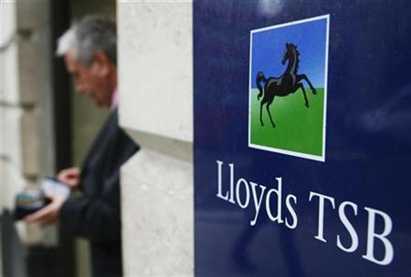 A customer leaves a branch of Lloyds TSB in the City of London October 13, 2008. REUTERS/Luke MacGregor