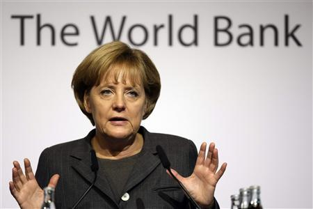 German Chancellor Angela Merkel gestures during her speech at the German World Bank Forum in Frankfurt November 20, 2008. REUTERS/Alex Grimm (GERMANY)