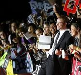 """<p>Cast member Kellan Lutz poses with a group of fans at the premiere of the movie """"Twilight"""" at the Mann Village and Bruin theatres in Westwood, California November 17, 2008. REUTERS/Mario Anzuoni</p>"""