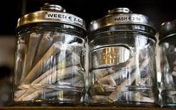 <p>Joints containing different types of cannabis are seen in their jars at a coffee shop in the southern Dutch city of Bergen op Zoom November 18, 2008. REUTERS/Jerry Lampen</p>