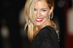 <p>British actress Sienna Miller arrives at the BAFTA (British Academy of Film and Television Arts) awards ceremony at The Royal Opera House in London February 10, 2008. REUTERS/Stephen Hird</p>