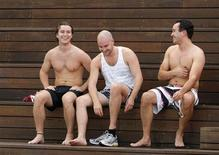 <p>A group of men relaxes after participating in a weekly, after-work biathlon at The Domain adjacent to Sydney's central business district November 20, 2008. REUTERS/Tim Wimborne</p>