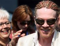 <p>Guns n Roses band member Axl Rose arrives for the British Grand Prix at the Silverstone race track in Northamptonshire, central England, June 11, 2006. REUTERS/Darren Staples</p>