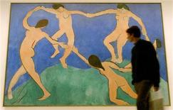 """<p>A man walks in front of the painting """"The Dance"""" (First Version) of French artist Henri Matisse (1869-1954) at an exhibition of New York's Museum of Modern Art (MoMA) in Berlin February 18, 2004. REUTERS/Arnd Wiegmann</p>"""