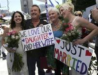 <p>Newlyweds Sharon Papo (L) and Amber Weiss (R) stand with Patti and David Weiss outside San Francisco City Hall after exchanging wedding vows on the first full day of legal same-sex marriages in California, June 17, 2008. REUTERS/Erin Siegal</p>