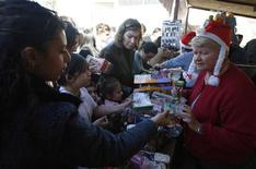 <p>Palestinians buy items at the Christmas market in Manger Square in the West Bank town of Bethlehem November 30, 2008. REUTERS/Ammar Awad</p>