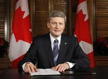 <p>Prime Minister Stephen Harper poses for a picture in his office on Parliament Hill in Ottawa, after taping a televised statement to the country, December 3, 2008. REUTERS/Chris Wattie</p>