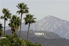 <p>The Hollywood Sign is seen between palm trees and snow dusted mountains in Los Angeles in this January 7, 2008 file photo. REUTERS/Danny Moloshok</p>