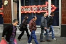 "<p>People walk past a ""time to shop"" sign in downtown San Francisco, December 9, 2008. REUTERS/Robert Galbraith</p>"