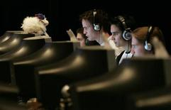 <p>Switzerland's team (R-L) Dimitri Kurt, Christian Kessler, Thomas Weber, and Martin Blaettler compete in the 'Counter-Strike' video game, at the World Cyber Games (WCG) 2004 in San Francisco, October 8, 2004. REUTERS/Kimberly White</p>