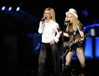 """<p>Madonna (R) performs with Britney Spears during the Los Angeles date of her """"Sticky and Sweet"""" tour at Dodgers stadium in Los Angeles November 6, 2008. REUTERS/Mario Anzuoni</p>"""