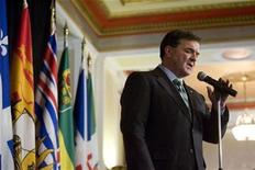 <p>Canada's Finance Minister Jim Flaherty talks with the media after an all day meeting with the provincial and territorial finance minister in Saskatoon, Saskatchewan December 17, 2008. REUTERS/David Stobbe</p>
