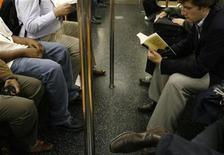 <p>A commuter reads his book while riding the subway in New York October 15, 2008. REUTERS/Lucas Jackson</p>
