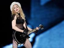 """<p>Madonna performs on stage during her """"Sticky and Sweet"""" tour at Monumental stadium in Buenos Aires, December 5, 2008. REUTERS/Marcos Brindicci</p>"""