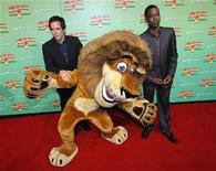 """<p>Actors Ben Stiller (L) and Chris Rock pose with the character """"Alex"""" the lion at the State Theatre in Sydney before the Australian premier of their new film """"Madagascar: Escape 2 Africa"""", November 17, 2008. REUTERS/Tim Wimborne</p>"""