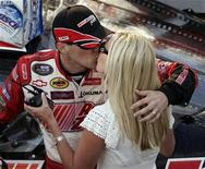 <p>NASCAR Busch driver Kevin Harvick (L) kisses his wife Delana following his win at the NASCAR Busch series auto race at Circuit Gilles Villeneuve in Montreal August 4, 2007. REUTERS/Christinne Muschi</p>