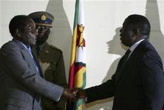 <p>Zimbabwe's President Robert Mugabe (L) shakes hands with Morgan Tsvangirai (R), leader of Zimbabwe's main opposition Movement for Democratic Change (MDC), in Harare, July 21, 2008. REUTERS/Philimon Bulawayo</p>