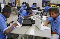 <p>Students at the Lilla G. Frederick Pilot Middle School work on their laptops during a class in Dorchester, Massachusetts June 20, 2008. REUTERS/Adam Hunger</p>