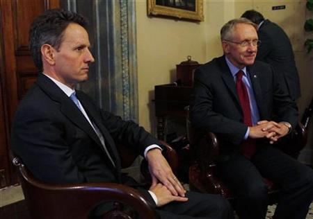 Treasury Secretary nominee Timothy Geithner meets with Senate Majority leader Harry Reid on Capitol Hill, December 9, 2008. REUTERS/Jim Young