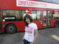 "<p>Atheist Bus Campaign creator Ariane Sherine poses for photographers in front of a bus bearing an atheist advertisement, at the launch of the campaign, in London in a January 6, 2009 file photo. Italian atheists have lost a bid to run ""no God"" advertisements on city buses after strong opposition from conservative political parties, a member of the group said on January 17, 2009. The ads reading ""The bad news is that God doesn't exist. The good news is that you don't need him"" were to have been put on buses in the northern city of Genoa, home to the Catholic cardinal who is head of the Italian Bishops Conference. REUTERS/Andrew Winning/Files</p>"