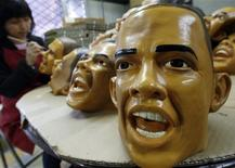 <p>An employee of Japan's Ogawa Rubber Inc paints an eye on a rubber mask depicting U.S president-elect Barack Obama at the company's factory in Saitama city, suburban Tokyo January 19, 2009. REUTERS/Yuriko Nakao</p>