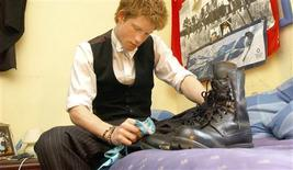 <p>Britain's Prince Harry, the younger son of the Prince of Wales, sits in his room at Eton College, Windsor as he polishes the boots that he wears while taking part in the Combined Cadet Force (CCF) in this June 7, 2003 file picture. As global recession deepens, some British fee-paying schools are feeling the pinch - even Eton College which has groomed the elite for centuries has set aside emergency funds to help tide over cash-strapped parents. To match feature FINANCIAL/BRITAIN-SCHOOLS REUTERS/Kirsty Wigglesworth/Pool/Files</p>