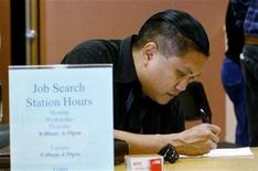 <p>Joseph Sullivan fills out a form at the Verdugo Jobs Center, a partnership with the California Employment Development Department, in Glendale, California November 7, 2008. REUTERS/Fred Prouser</p>
