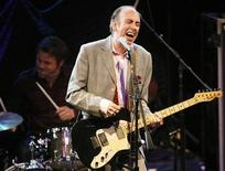 <p>Mick Jones, former guitarist and vocalist of punk rock band The Clash, performs with his new band Carbon/Silicon at the 2008 NME Awards USA at El Rey theatre in Los Angeles April 23, 2008. REUTERS/Mario Anzuoni</p>