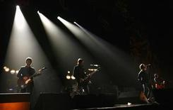 <p>Oasis perform at the Brit Awards at the Earls Court Arena in London, February 14, 2007. REUTERS/Kieran Doherty</p>