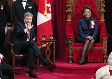 <p>Canada's Governor General Michaelle Jean (R) and Prime Minister Stephen Harper laugh before the Speech from the Throne in the Senate chamber on Parliament Hill in Ottawa January 26, 2009. REUTERS/Chris Wattie</p>