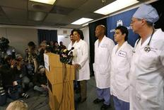 <p>Doctor Karen Maples (4th R) , Chief of Service, Obstetrics and Gynecology, speaks during a news conference about the conditions of the octuplets in Bellflower, California January 27, 2009. A California woman shocked doctors by giving birth on Monday to octuplets, believed to be only the second set of eight babies born in the United States. The six boys and two girls were doing well and were in stable condition in the neonatal intensive care unit, said Dr. Maples. REUTERS/Mario Anzuoni</p>