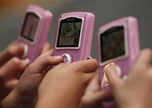 """<p>Girls play with """"My Life"""" toys at the Dream Toys exhibition in London in this October 15, 2008 file photo. REUTERS/Stephen Hird</p>"""