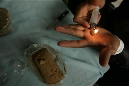 A dealer tests hashish resin near Chefchaouen March 27, 2008. REUTERS/Rafael Marchante