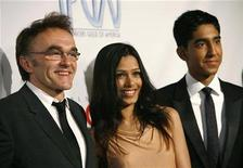 "<p>Indian actress Freida Pinto (C) and British actor Dev Patel (R), cast members of the movie ""Slumdog Millionaire,"" pose with director of the movie Danny Boyle at the 20th annual Producers Guild Awards at The Hollywood Palladium in Los Angeles, January 24, 2009. REUTERS/Mario Anzuoni</p>"