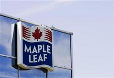 <p>A sign for the Maple Leaf food processing plant is seen in Toronto in this August 21, 2008 file photo. The company said on Monday it has reached a tentative $25 million settlement in a series of class-action lawsuits related to an outbreak of listeriosis food poisoning that killed at least 20 people last year. REUTERS/Mark Blinch</p>